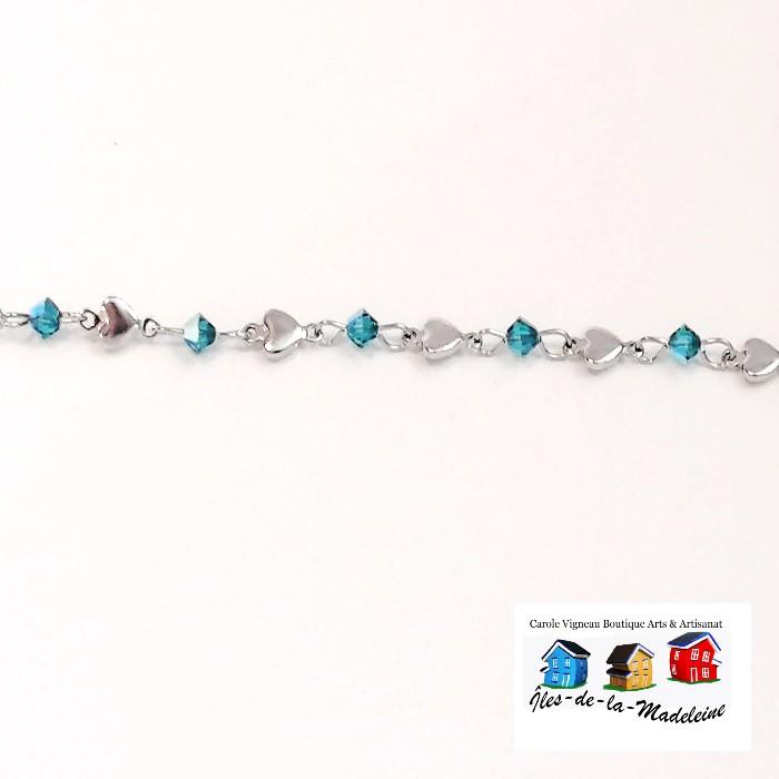Bracelet  composé de cœurs en acier inoxydable assortis de  cristaux de couleur Zircon.